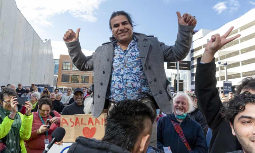 Christchurch survivor Abdul Aziz Wahabzadah celebrates with supporters outside the high court after the sentencing.