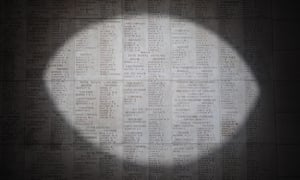 A pool of light illuminates the engraved names of the missing at the Menin Gate Memorial in Ypres, Belgium