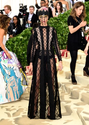 Current British Vogue cover star Cara Delevingne was responsible for one of the most dramatic ensembles of the evening – a caged creation by Christian Dior.