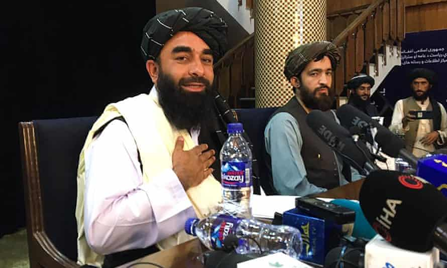 Taliban spokesperson Zabihullah Mujahid attends the first press conference in Kabul.
