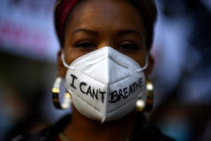 Madrid, Spain A woman wears a mask during a demonstration against racism and in solidarity with the Black Lives Matter movement, in the wake of the killing of George Floyd in Minneapolis