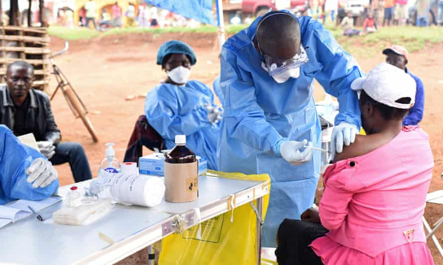 A Congolese health worker administers Ebola vaccine to a woman in North Kivu.