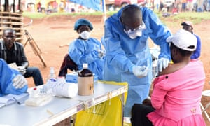 A health worker administers the Ebola vaccine in the village of Mangina in the North Kivu province of the Democratic Republic of the Congo.