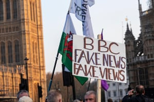 Protesters with a sign reading 'BBC fake news' in Westminster, London, May 2019