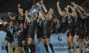 The Exeter players lift the trophy.