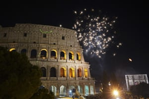 Fireworks explode over Rome's Colosseum during New Year's celebrations.