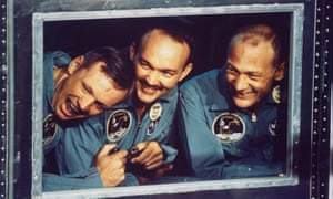 Apollo 11 astronauts Buzz Aldrin, Michael Collins, & Neil Armstrong peering out window of quarantine room aboard recovery ship Hornet following splashdown