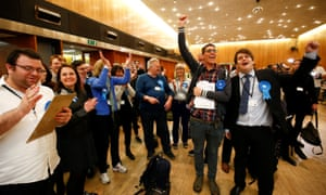 Conservative party Supporters react during the count at Wandsworth town hall in south-west London.