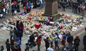 Tributes to the victims in St Ann's Square in Manchester.