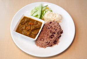 'A kick of allspice and chilli': curry goat with rice and peas.