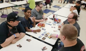 A group plays cards to pass the time at the shelter at Marianna high school in Florida.