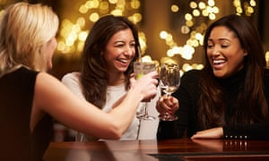 Group of female friends enjoying a drink in a bar