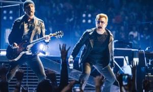 U2 perform on stage