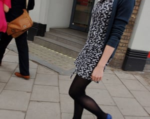 Haute or not? A woman wearing black tights and a summer dress