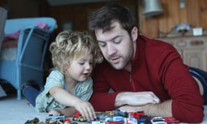 Father and toddler playing