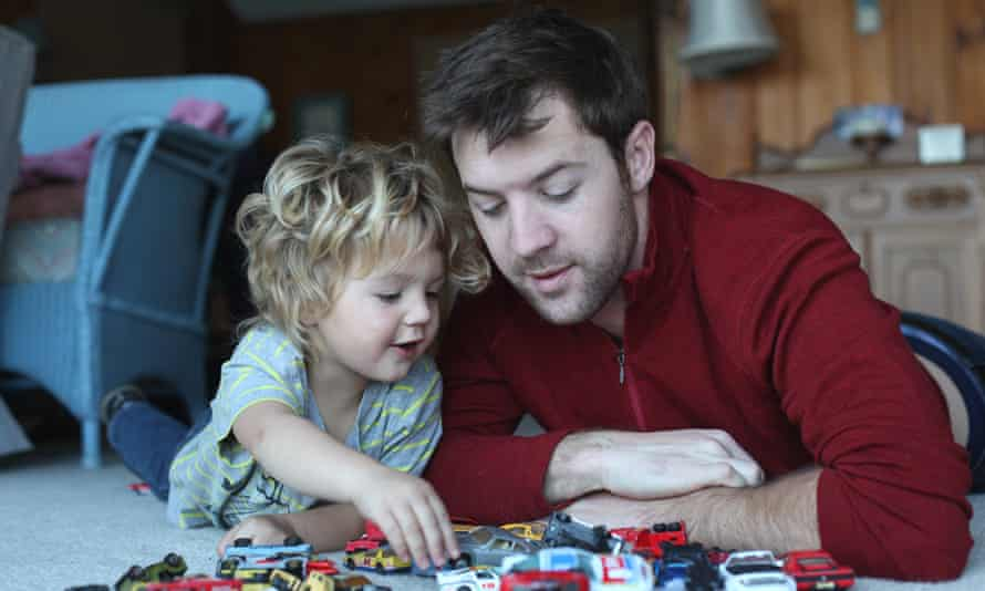 Father and child playing cars