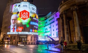 general election results projected on to the BBC's broadcasting house in london