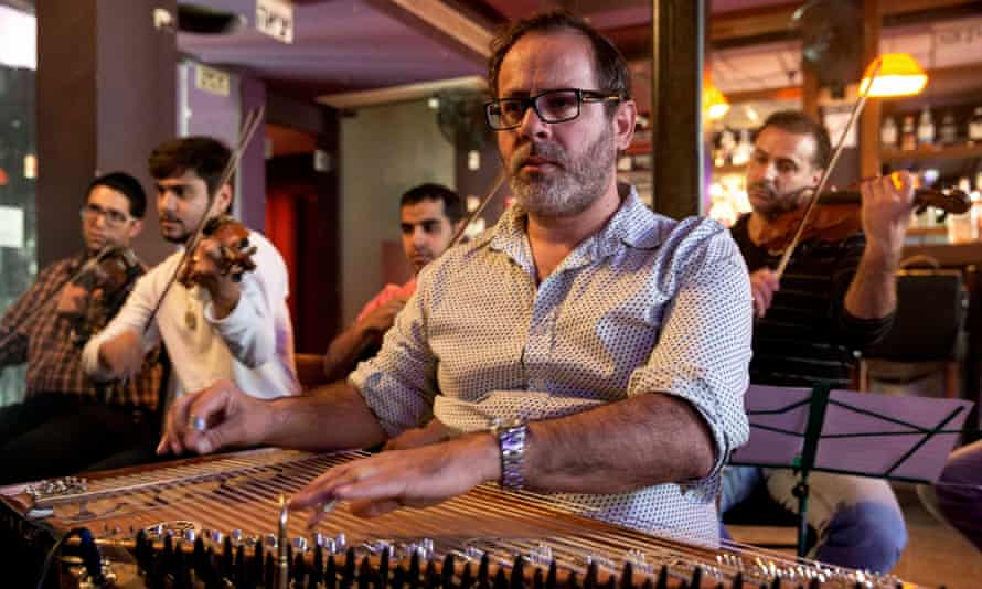 The Firqat Alnoor orchestra rehearses in Tel Aviv. The instrument in the centre of the picture is the kanun, prominent in eastern music either as a solo instrument or part of an ensemble.
