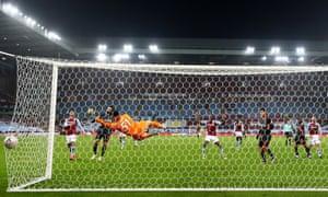 Liverpool's Sadio Mane scores their third goal.
