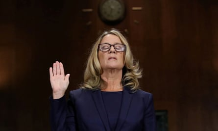Christine Blasey Ford is sworn in before testifying before the Senate judiciary committee on 27 September.