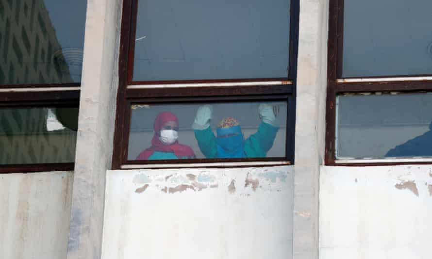 Yemeni nurses look out of a hospital window amid concerns over a second wave of coronavirus infections.