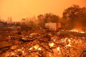 Businesses continue to burn under a darkened smokey sky in Paradise, north of Sacramento, California on November 09, 2018.