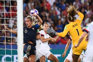 France's Amandine Henry jumps for the ball.