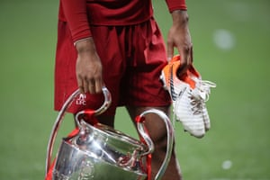 Liverpool's Virgil van Dijk celebrates with the trophy.