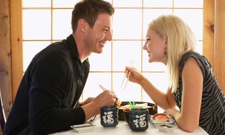 Couple eating in Japanese restaurant