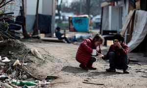 Children play in the camp of a Roma community that was attacked during the night of 25 March in Bobigny, near Paris.