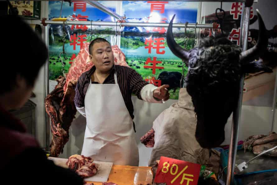 A butcher sells Yak meat at a market in Beijing. In recent years China has sought to expand commercial production of the meat.