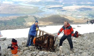 Undated photo issued by the John Muir Trust of Paul Nelson and Andrew Hunter with a piano that they found on Ben Nevis.