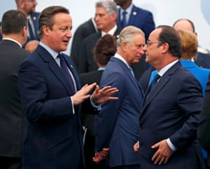 British prime minister David Cameron talks to French president Francois Hollande, as Prince Charles, walks past, on the opening day of UN climate talks in Paris
