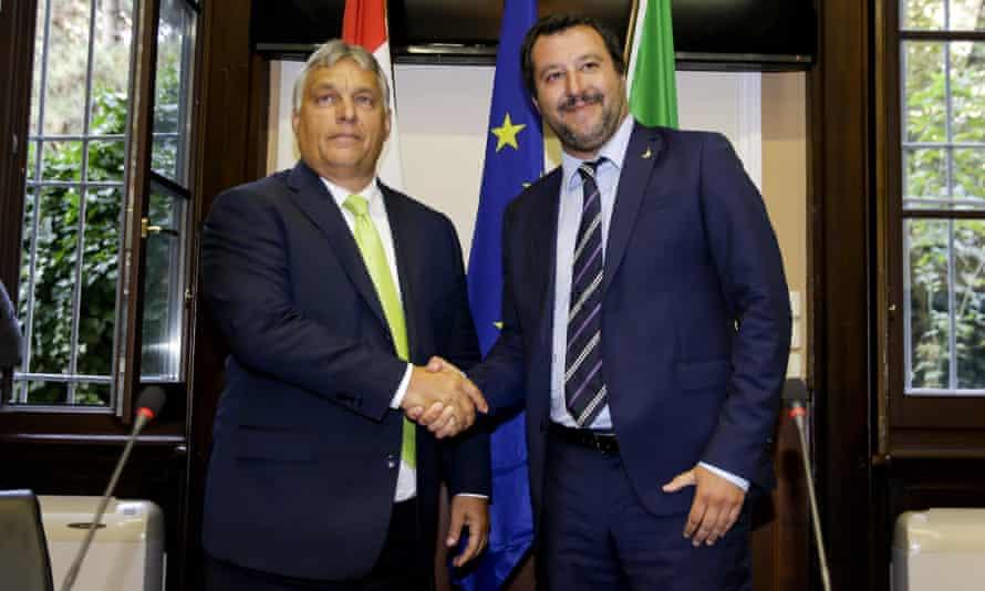 Matteo Salvini shakes hands with Viktor Orbán