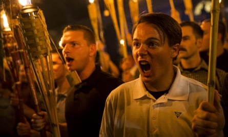 Neo-Nazis and white supremacists march in Charlottesville on 11 August. The rally and subsequent death of a counter-protester were decried as real-world consequences of far-right online movements.