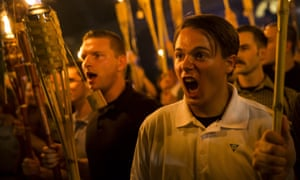 White supremacists march with torches in Charlottesville, Virginia on 11 August 2017.
