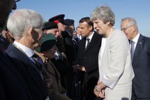 Theresa May and Emmanuel Macron greet British D-Day veterans at Ver-sur-Mer, Normandy