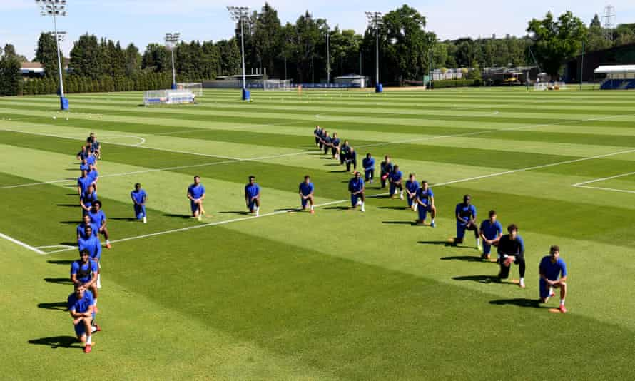 The Chelsea squad take the knee during a training session at Cobham earlier this month.
