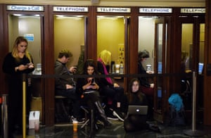 Journalists file information inside phone booths at the public impeachment hearings on 19 November 2019 on Capitol Hill in Washington DC.