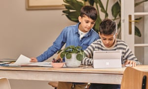 Two children using a Microsoft Surface