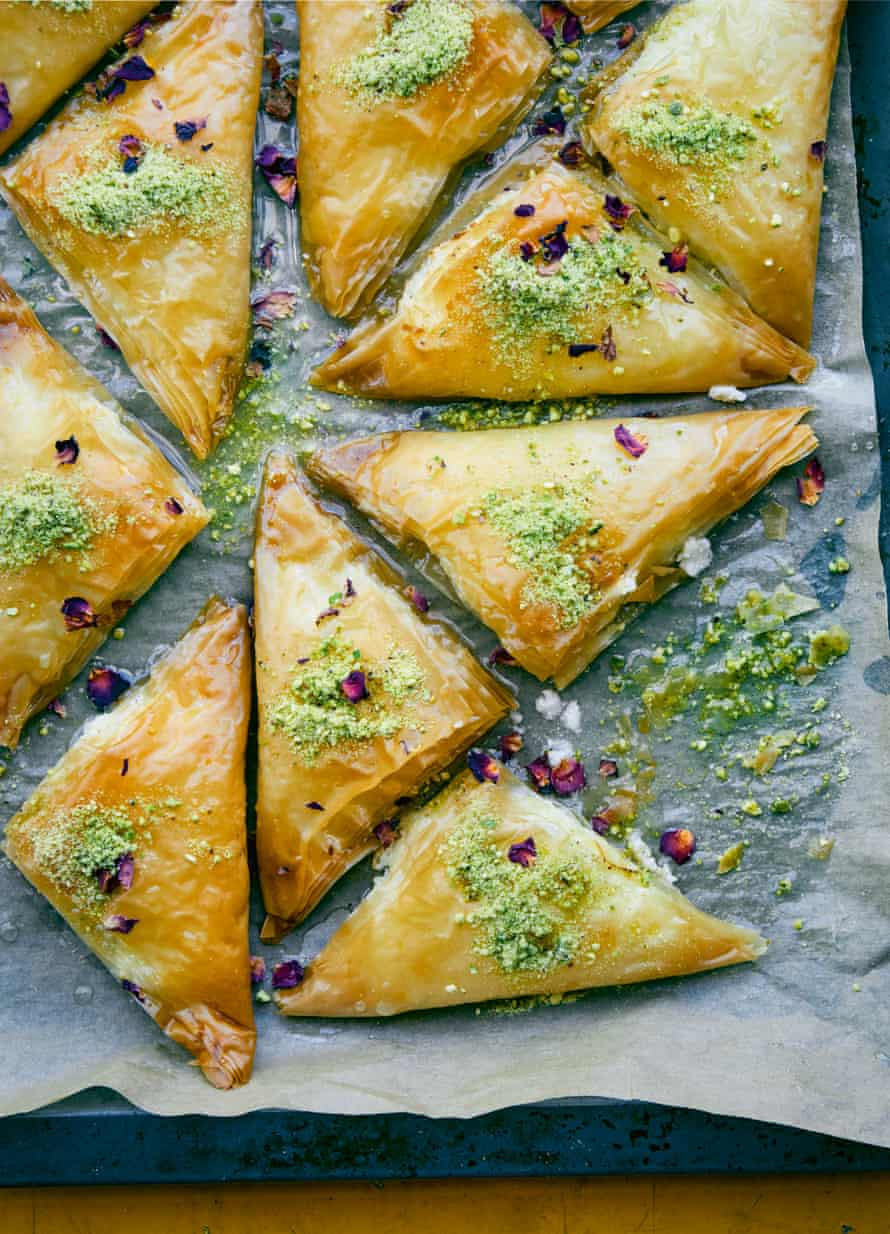 Filo triangles with cream cheese, pistachio and rose.