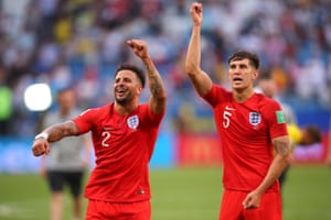 Kyle Walker and John Stones celebrate the win infront of the England fans.