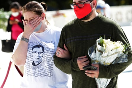 Mourners carried flowers and wore T-shirts hailing the 'Notorious RBG'.