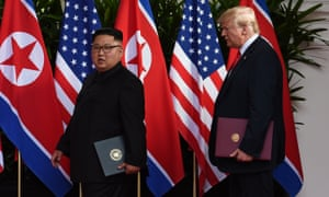 Kim and Trump walk off with their signed documents