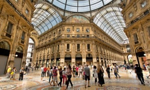 Shoppers in the high-ceilinged Galleria Vittorio Emanuele II.