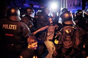 Anti-riot police arrest a protester
