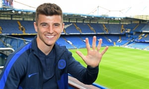 Chelsea's Mason Mount holds up his hand to signify the five-year contract he has just signed