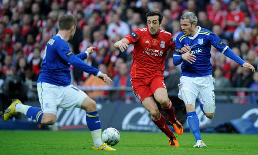 José Enrique cuts between two Cardiff players in the 2012 League Cup final with Liverpool.