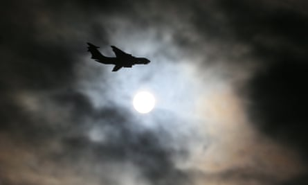 a russian plane flies past the sun during a military exercise