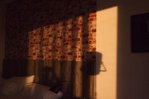 Sunlight shining through window into hotel room